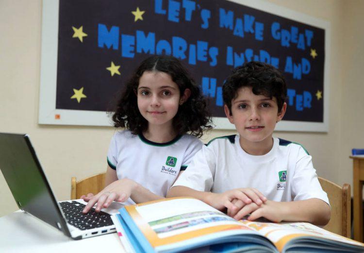 Vitória e Joaquim, de 8 anos, são alunos da Builders. Foto: Alex Silva/Estadão